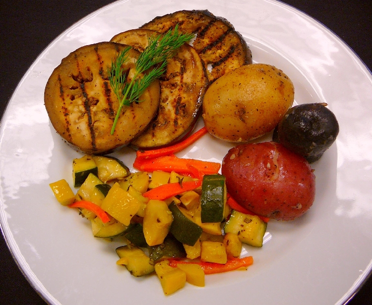 Photo: Grilled Eggplant Slices, Fresh Seasonal Vegetables, Papas 'Tres Colores'.