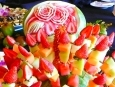 Fruit Skewers, in front of Carved Watermelon.